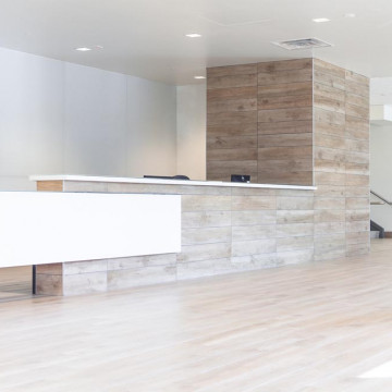 A Sleek, Tile and Glass Reception Desk