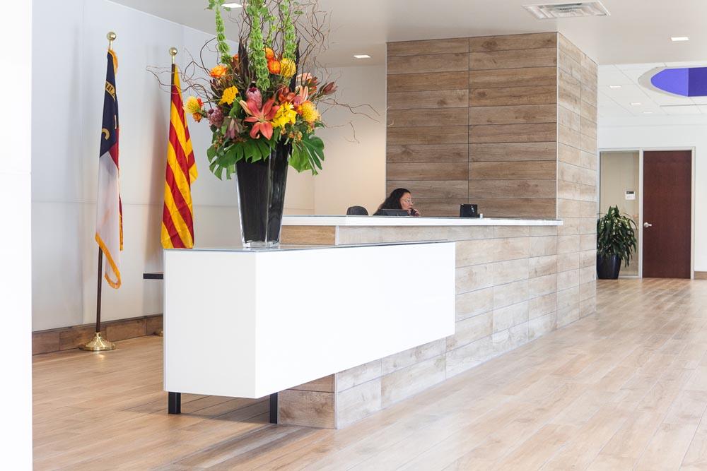 A sleek tile and glass reception desk alicia hylton daniel for Back painted glass tile